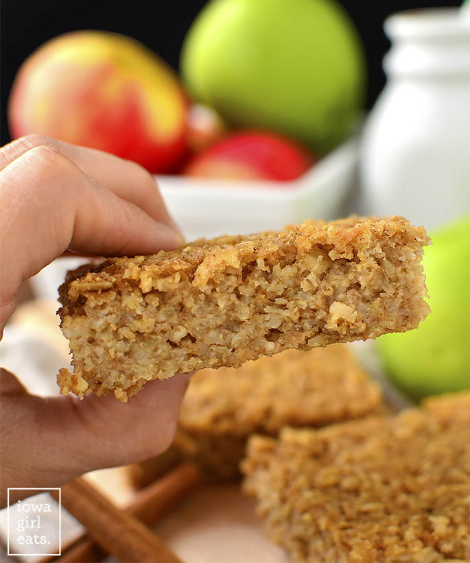 Hand holding apple oatmeal bar
