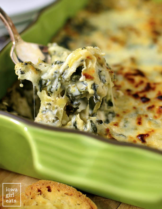 Caesar Spinach and Artichoke Dip kicks traditional spinach and artichoke dip up a notch! This 5 ingredient (plus seasoned salt!) easy, gluten-free dip recipe is irresistible. | iowagirleats.com