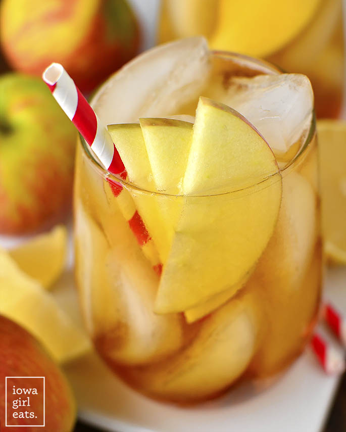 Sparkling Maple Bourbon Ciders are for when you're feeling extra giggly! Maple-swirled bourbon is topped with hard apple cider in this delicious, fall-inspired, 3-ingredient drink recipe. | iowagirleats.com