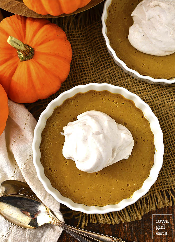 Mini Crustless Pumpkin Pies have all the sweetness and spice of regular pumpkin pie but are naturally sweetened, gluten-free, and dairy-free too! | iowagirleats.com