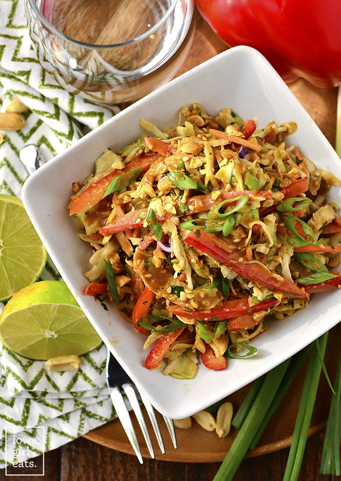 Thai Crunch Salad with Thai Peanut Dressing is a light and healthy gluten-free salad recipe that's packed with savory flavor. This is one salad you will not mind eating!  | iowagirleats.com
