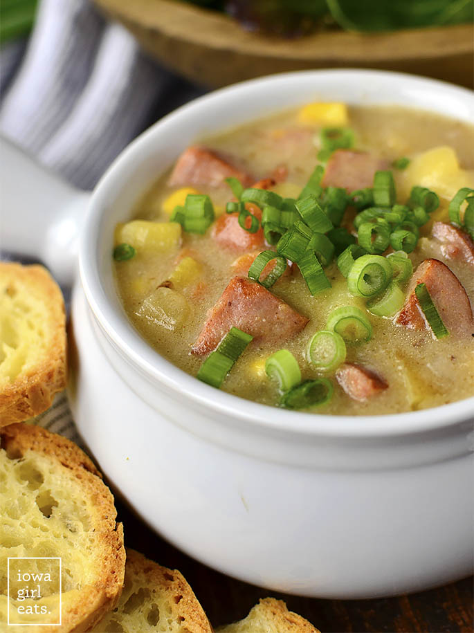 Sweet Corn, Kielbasa and Potato Soup is for the coldest of nights! This hearty and comforting, gluten-free soup recipe is filled with sweet corn, savory kielbasa and bacon, and creamy potatoes. | iowagirleats.com