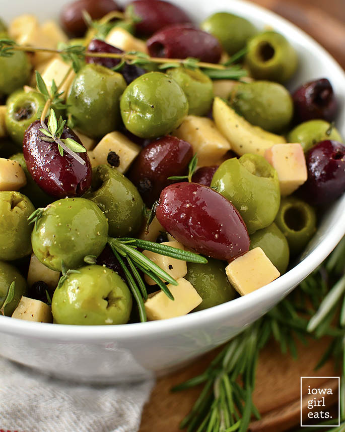 Bowl of mixed olives, herbs, and garlic.