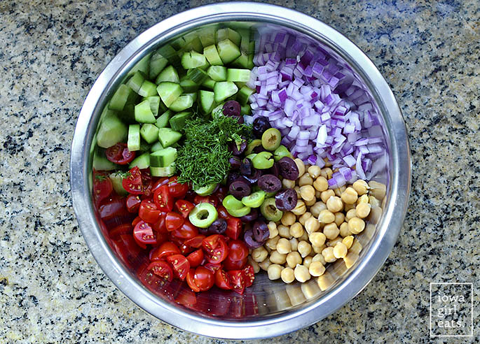 Meal-Prep Greek Chickpea Salad is a fresh and filling lunch idea! Make a big batch then divy into mason jars with lettuce for easy, on-the-go gluten-free lunches all week. | iowagirleats.com