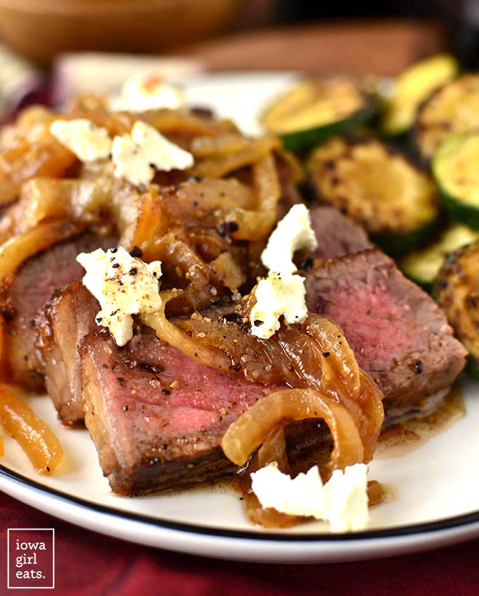 Pan-Roasted Steak with Caramelized Onions and Goat Cheese is decadent beyond measure! Perfect for date night or anytime you want a delicious and indulgent dinner at home. | iowagirleats.com