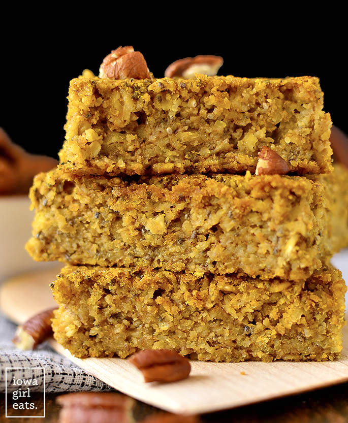 Maple Pumpkin Oatmeal Breakfast Bars stacked on a plate.
