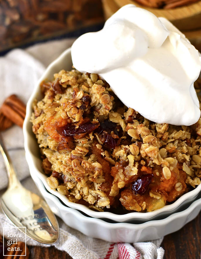 Photo of a bowl of Maple-Pecan Apple, Cranberry, Sweet Potato Crisp