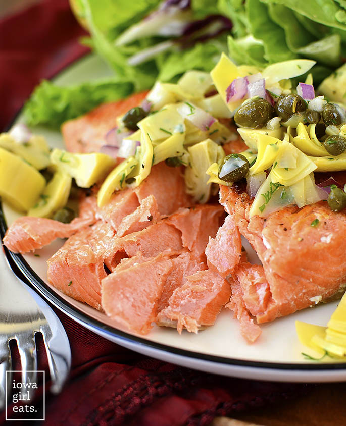 Pan-Seared Salmon with Lemon-Artichoke Salsa cut with a fork