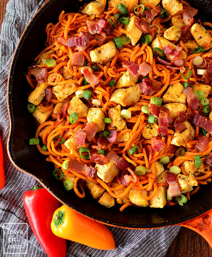 overhead photo of buffalo chicken bacon and sweet potato noodle skillet