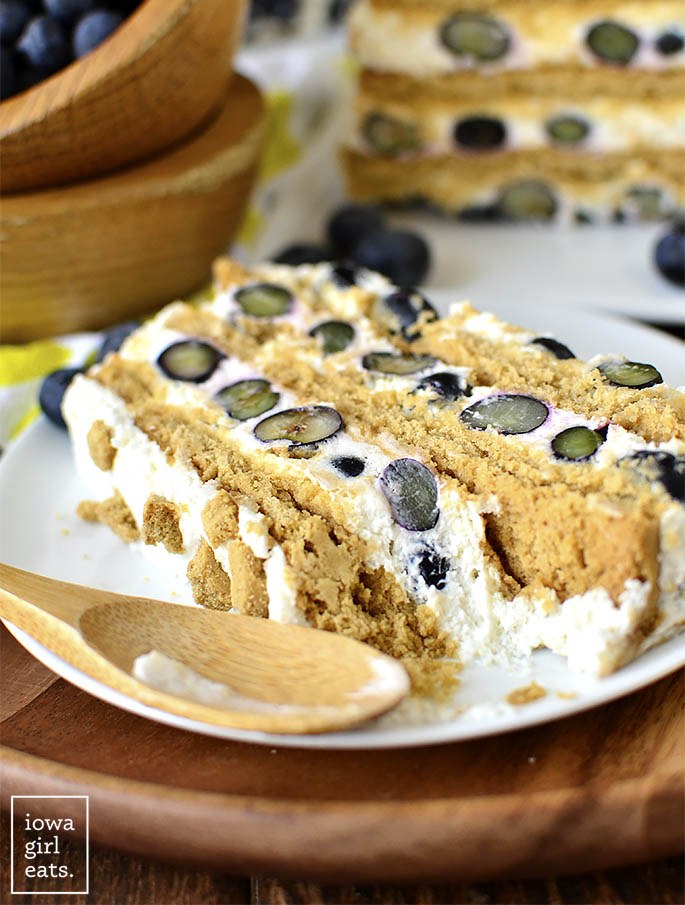 Gluten free Lemon-Blueberry Icebox Cake with a bite taken out of it.