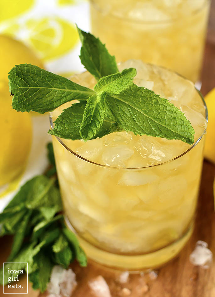 Mint garnish on a glass of Lemon-Ginger Mint Juleps | iowagirleats.com