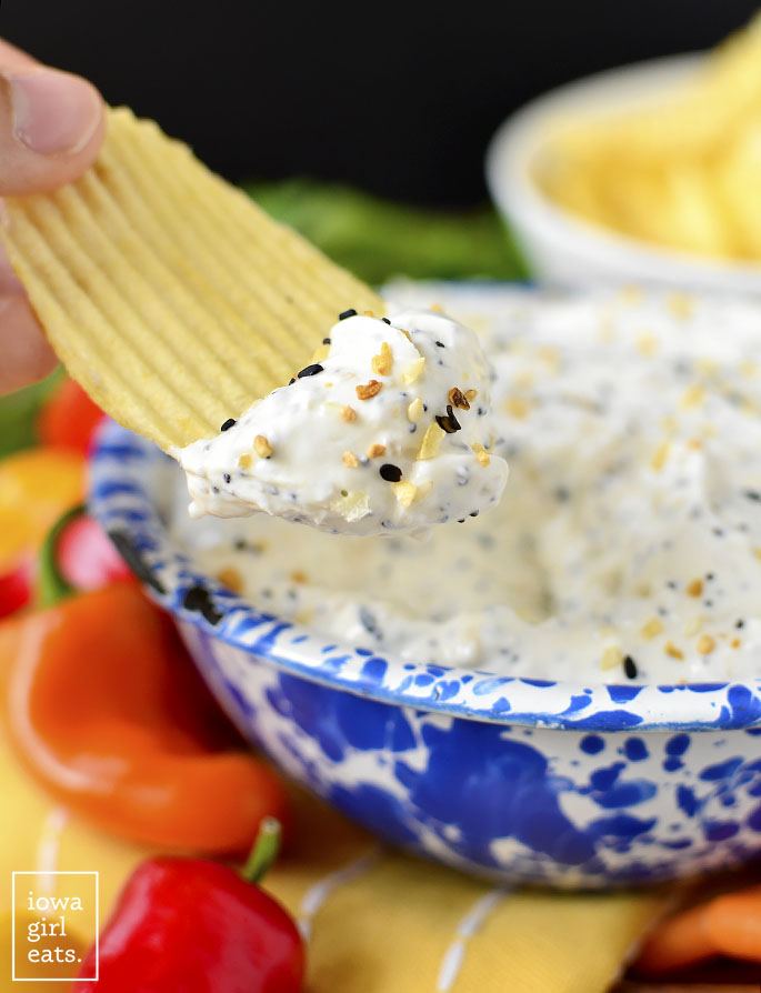 Chip dipping into a bowl of Copycat Trader Joe's Everything But the Bagel Dip