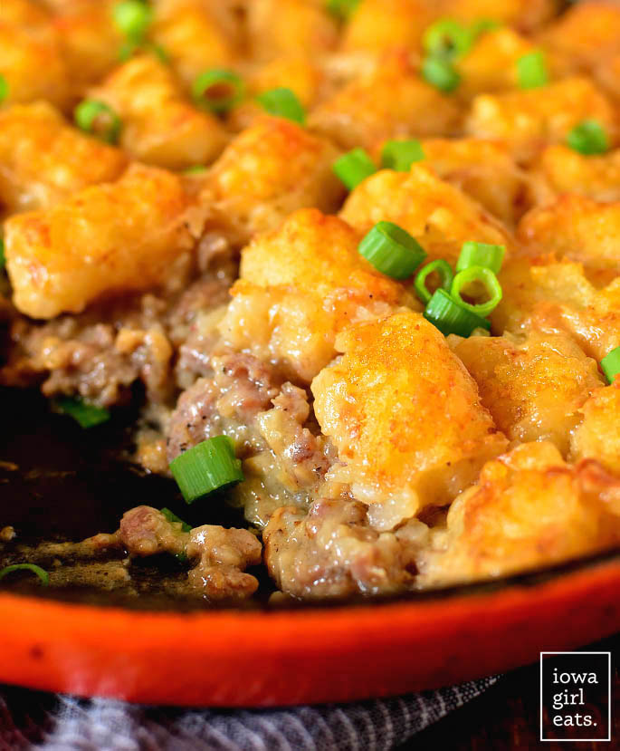 Close up of Sausage Gravy Breakfast Tater Tot Casserole in the skillet