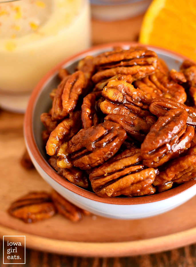 Close up photo of bowl of Orange Candied Pecans