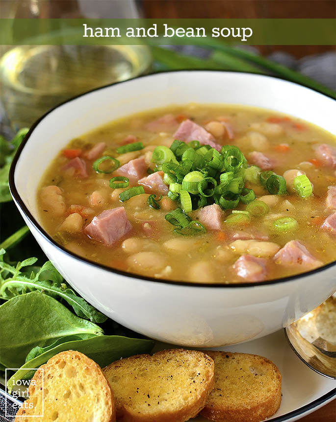 Bowl of Ham and Bean Soup on a plate with a salad