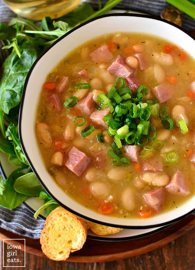 overhead photo of ham and bean soup with green onions