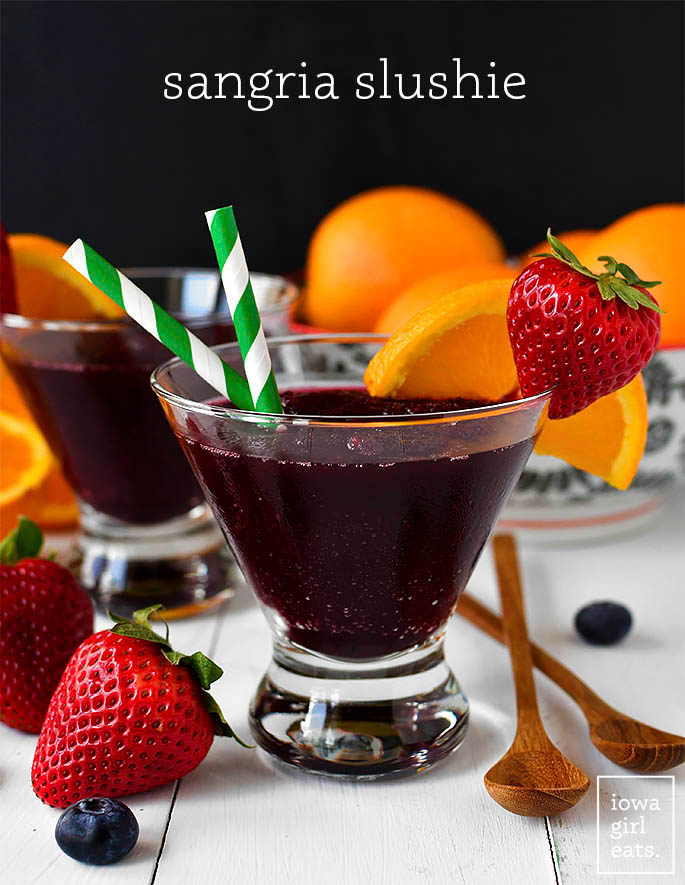 sangria slushies in glasses with a straw