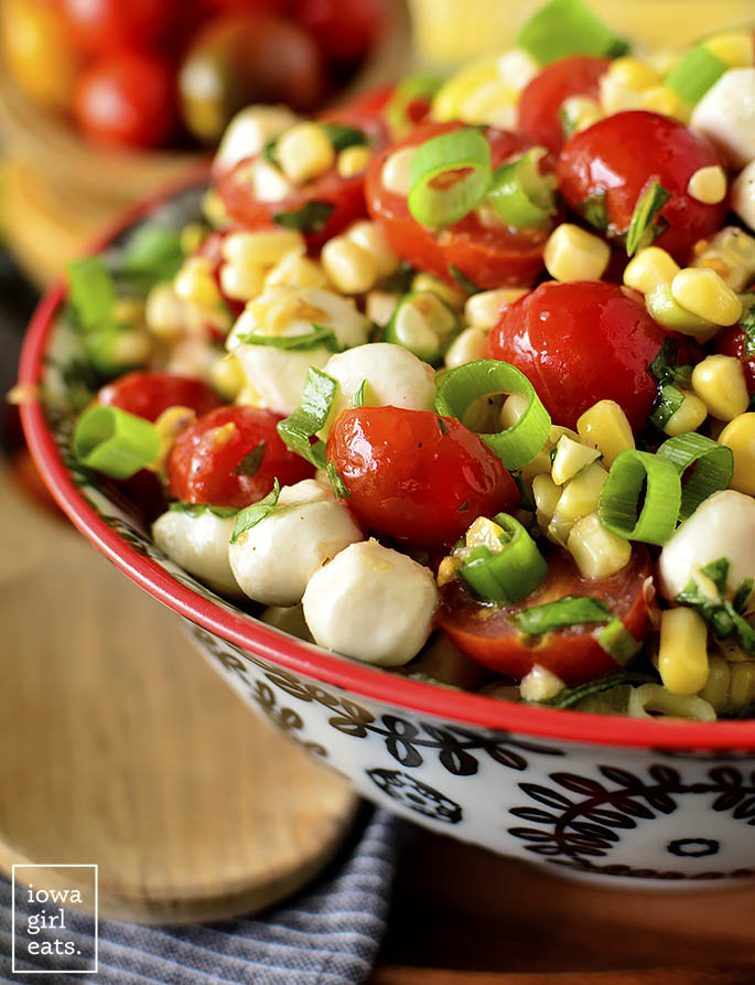 Close up photo of Sweet Corn Caprese Salad in a serving bowl