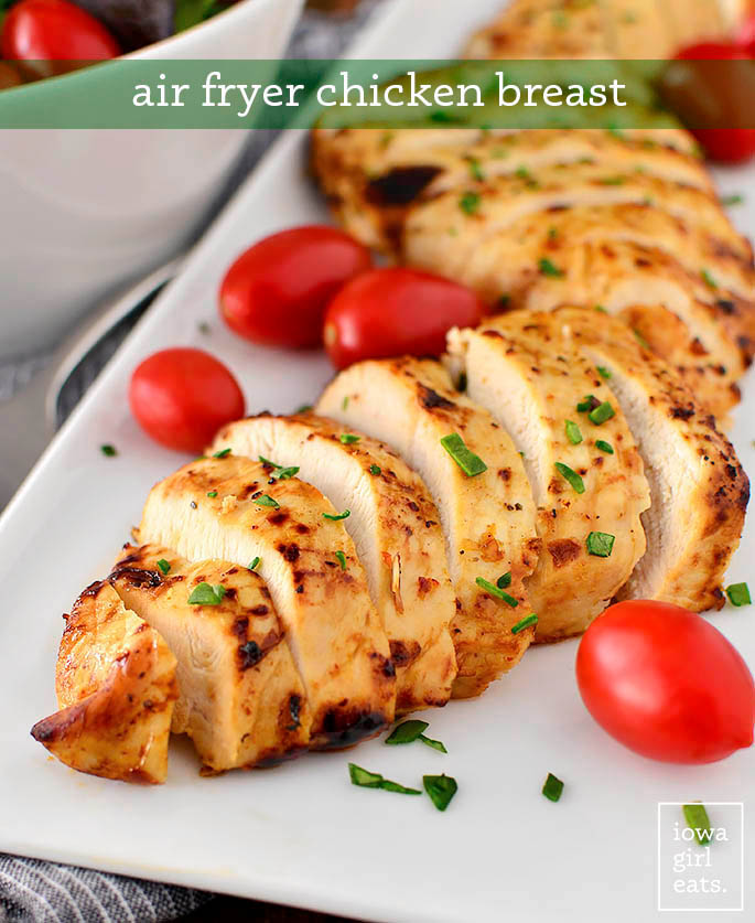 Chicken breast cooked in the air fryer sliced on a platter