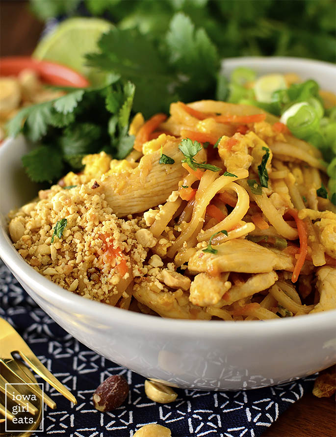 Close up photo of bowl of chicken pad thai