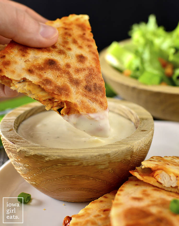 Buffalo Chicken Quesadilla dunking into ranch dressing