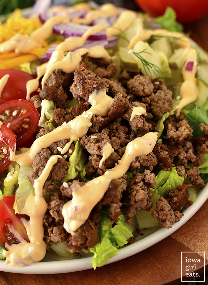ground beef on a salad with special sauce salad dressing