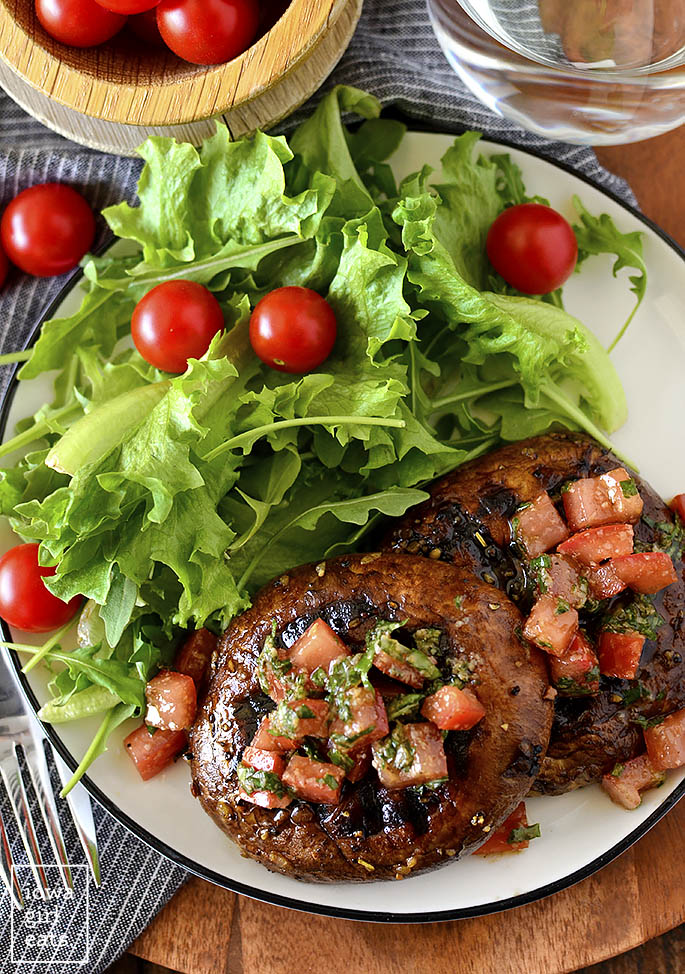 overhead Photo of grilled portobello mushrooms with bruschetta topping