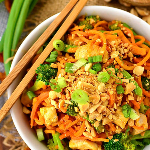 Thai Peanut Chicken and Sweet Potato Noodles in a bowl