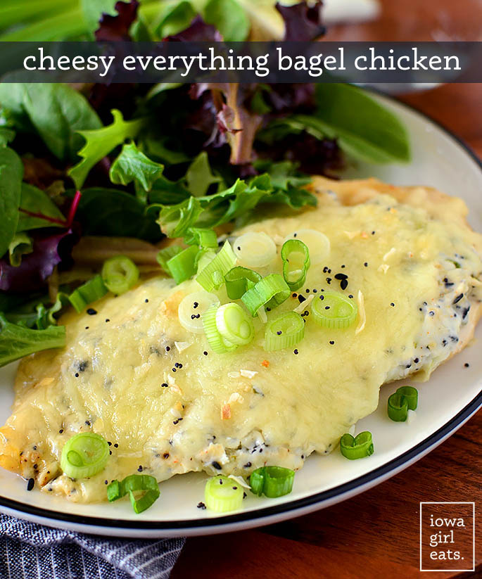 cheesy everything bagel chicken on a plate with a salad